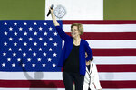 Democratic presidential candidate Sen. Elizabeth Warren, D-Mass., waves to the crowd during a campaign rally at Wakefield High School, in Arlington, Va., Thursday, Feb. 13, 2020. (AP Photo/Jose Luis Magana)