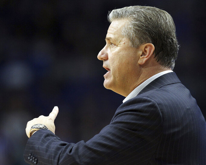 Kentucky head coach John Calipari directs his team during the second half of an NCAA college basketball game against Utah Valley in Lexington, Ky., Monday, Nov. 18, 2019. Kentucky won 82-74. (AP Photo/James Crisp)