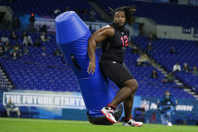 Ohio State defensive lineman Davon Hamilton runs a drill at the NFL football scouting combine in Indianapolis, Saturday, Feb. 29, 2020. (AP Photo/Michael Conroy)