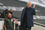Tottenham's manager Jose Mourinho reacts during the English Premier League soccer match between Tottenham Hotspur and Manchester United at the Tottenham Hotspur Stadium in London, Sunday, April 11, 2021. (Matthew Childs/Pool via AP)