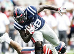 Mississippi's D'Vaughn Pennamon runs during the Grove Bowl spring NCAA college football game at Vaught-Hemingway Stadium in Oxford, Miss., Saturday, April 6, 2019. (Bruce Newman/The Oxford Eagle via AP)