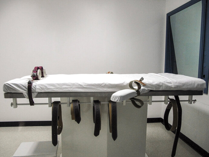 FILE - This July 7, 2010 file photo, shows Nebraska's lethal injection chamber at the State Penitentiary in Lincoln, Neb. The lethal injection protocol that was used in 2018 to execute a Nebraska prisoner survived a legal challenge Friday, Oct. 18, 2019, from death penalty opponents who had hoped to overturn it to prevent the state from carrying out capital punishment. (AP Photo/Nate Jenkins, File)