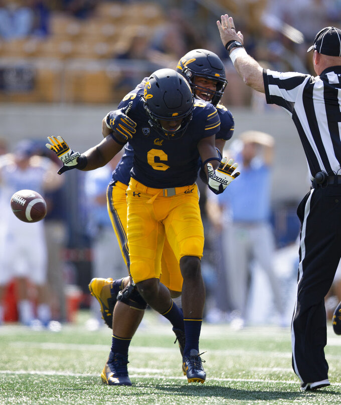 California's Jaylinn Hawkins (6) and Luc Bequette (93) celebrate Hawkins' interception of a pass by North Carolina quarterback Nathan Elliott during the second half of an NCAA college football game, Saturday, Sept. 1, 2018, in Berkeley, Calif. Cal won 24-17. (AP Photo/D. Ross Cameron)