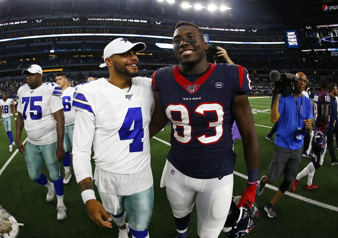 Dallas Cowboys quarterback Dak Prescott (4) and Houston Texans tight end Jordan Thomas (83) talk after their preseason NFL football game in Arlington, Texas, Saturday, Aug. 24, 2019. (AP Photo/Ron Jenkins)
