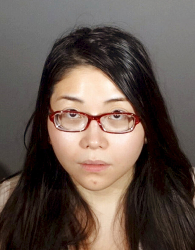 This undated booking photo provided by the Whittier, Calif., Police Department shows Andrea Dorothy Chan Reyes. Chan Reyes, suspected in a hit-and-run crash that killed a bicyclist in Southern California three years ago, has been returned on Thursday, Oct. 29, 2020, to the U.S. to face trial after her arrest in Australia. Authorities say Chan Reyes fled the country after hitting Agustin Rodriguez Jr. with her Lexus in 2017. He died at the scene in Whittier, east of Los Angeles. (Whittier Police Department via AP)