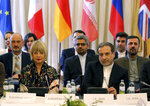 The European Union's political director Helga Schmid and Iran's deputy Foreign Minister Abbas Araghchi, from left, wait for a bilateral meeting as part of the closed-door nuclear talks with Iran at a hotel in Vienna, Austria, Sunday, July 28, 2019.