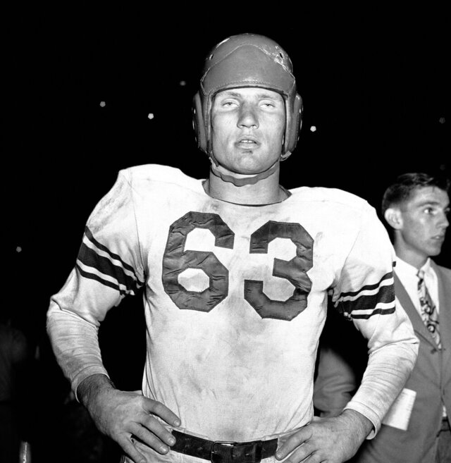 FILE - This Nov. 2, 1948, file photo shows Y.A. Tittle of Baltimore Colts football team. He was 21 and balding, with a quirky name and a Hall of Fame arm that would set him apart if the other stuff didn't. In the early years of the Baltimore Colts, Yelberton Abraham (Y.A.) Tittle wowed football fans who rallied around the young quarterback of their fledgling football team.(AP Photo/Zimmerman, File)