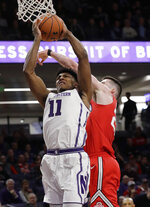 Northwestern guard Anthony Gaines, left, drives to the basket past Ohio State forward Kyle Young during the second half of an NCAA college basketball game Wednesday, March 6, 2019, in Evanston, Ill. (AP Photo/Nam Y. Huh)