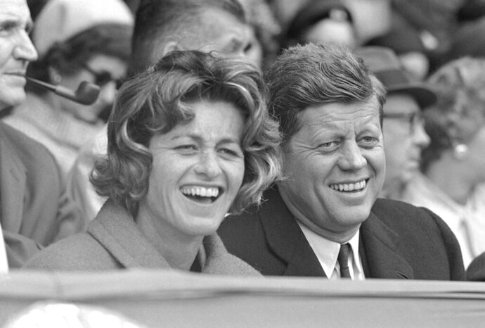 FILE - In this April 10, 1961, file photo, President John F. Kennedy and his sister, Jean Kennedy Smith, watch an opening day baseball game at Griffith Stadium in Washington.  Smith, the youngest sister and last surviving sibling of President John F. Kennedy, died at 92, her daughter Kym confirmed to the New York Times. (AP Photo/File)