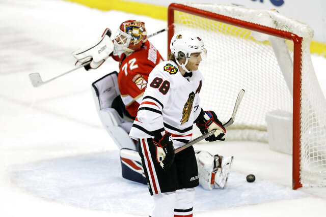 Chicago Blackhawks right wing Patrick Kane (88) skates away after scoring against Florida Panthers goaltender Sergei Bobrovsky (72) during a shootout of an NHL hockey game, Saturday, Feb. 29, 2020, in Sunrise, Fla. (AP Photo/Brynn Anderson)