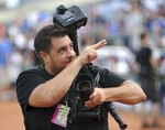 In this  Aug. 5, 2012, photo provided by Christopher Pasatieri, New York Post photographer Anthony J. Causi is shown acknowledging the crowd during a local sporting event in New York. Causi, a highly skilled and popular sports photographer who covered New York city teams for 25 years, died Sunday, April 12, 2020, from complications caused by coronavirus. He was 48. (Christopher Pasatieri via AP)