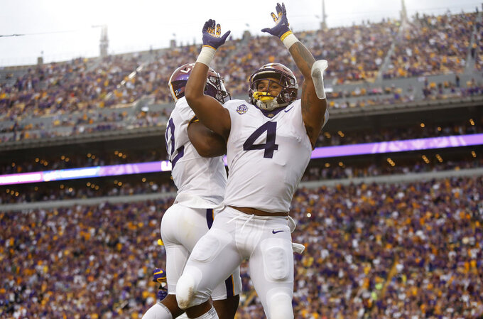 LSU running back Nick Brossette (4) and wide receiver Jonathan Giles (12) celebrate a play during an NCAA college football game against Mississippi State in Baton Rouge, La., Saturday, Oct. 20, 2018. LSU won 19-3. (AP Photo/Tyler Kaufman)