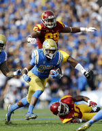 UCLA running back Joshua Kelley (27) runs against Southern California during the first half of an NCAA college football game Saturday, Nov. 17, 2018, in Pasadena, Calif. (AP Photo/Marcio Jose Sanchez)