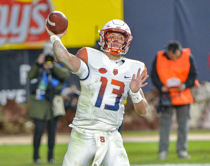 Syracuse quarterback Tommy DeVito (13) throws a pass during an NCAA college football game against Notre Dame, Saturday, Nov. 17, 2018, at Yankee Stadium in New York. (AP Photo/Howard Simmons)