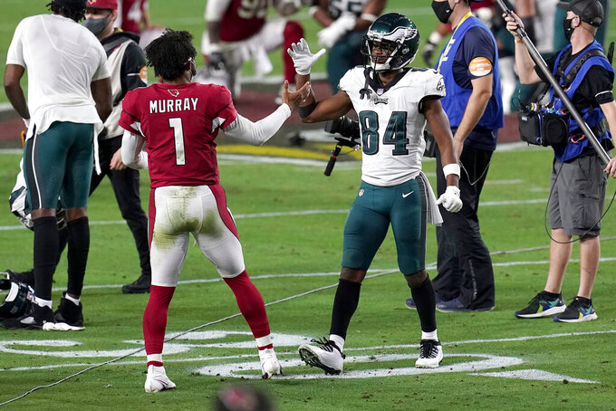 Arizona Cardinals quarterback Kyler Murray (1) greets Philadelphia Eagles wide receiver Greg Ward (84) after an NFL football game, Sunday, Dec. 20, 2020, in Glendale, Ariz. The Cardinals won 33-26. (AP Photo/Ross D. Franklin)