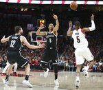 Brooklyn Nets forward Joe Harris, left, and guard D'Angelo Russell and Portland Trail Blazers guard Rodney Hood go for a loose ball during the first half of an NBA basketball game in Portland, Ore., Monday, March 25, 2019. (AP Photo/Randy L. Rasmussen)