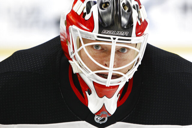 "FILE - In this Oct. 9, 2017, file photo, New Jersey Devils goalie Corey Schneider (35) skates prior to the first period of an NHL hockey game against the Buffalo Sabres in Buffalo, N.Y. NHL players are concerned the league will announce a ""drop-dead"" deadline for returning to action. New Jersey Devils goaltender Cory Schneider said Monday, May 18, 2020, in a telephone conference call players are asking about a deadline more often in recent weeks as the pause due to the coronavirus pandemic has passed the two-month mark. (AP Photo/Jeffrey T. Barnes, File)"