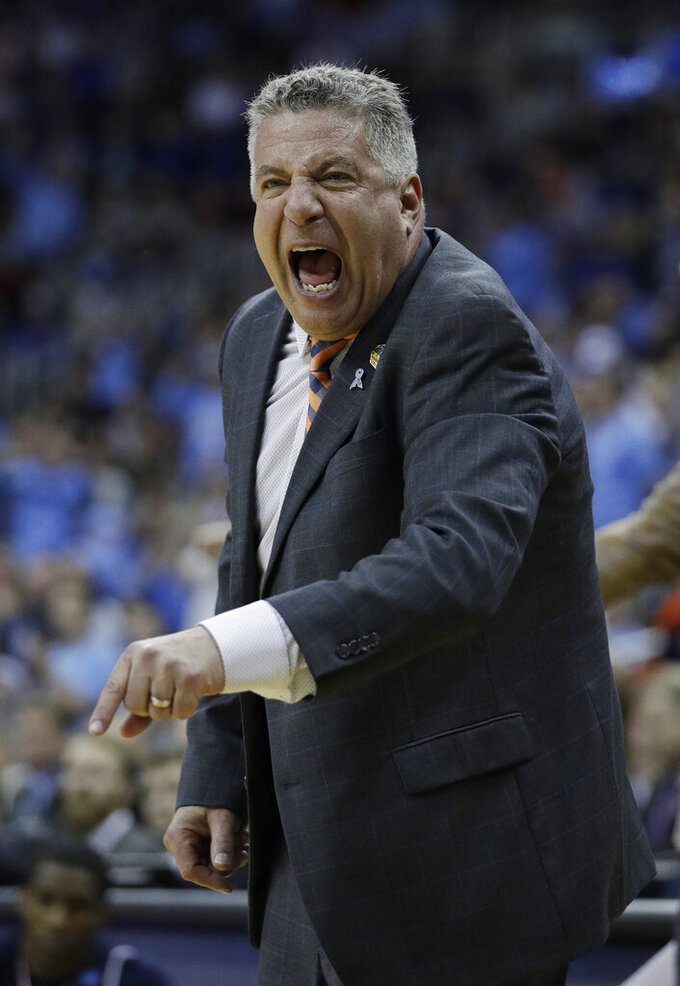 Auburn head coach Bruce Pearl yells from the sidelines during the first half of a men's NCAA tournament college basketball Midwest Regional semifinal game against North Carolina Friday, March 29, 2019, in Kansas City, Mo. (AP Photo/Charlie Riedel)
