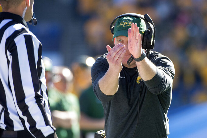North Dakota State head coach Chris Klieman calls a timeout during the second half of the FCS championship NCAA college football game against Eastern Washington, Saturday, Jan. 5, 2019, in Frisco, Texas. It was Klieman's last game at North Dakota State before he takes over as head coach at Kansas State. (AP Photo/Jeffrey McWhorter)