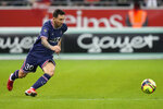 PSG's Lionel Messi in action during the France League One soccer match between Reims and Paris Saint-Germain, at the Stade Auguste-Delaune in Reims, France, Sunday, Aug. 29, 2021. (AP Photo/Francois Mori)