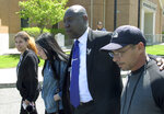 Attorney Ben Crump, center, and relatives of Anthony Jose Vega Cruz leave a gathering in Wethersfield, Conn., on Wednesday, May 8, 2019 to talk about the killing of Vega Cruz by a Wethersfield police officer. Officer Layau Eulizier fatally shot Vega Cruz on April 20 as Vega Cruz drove toward the officer while fleeing a traffic stop. (AP Photo/Dave Collins)