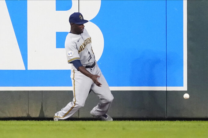 Milwaukee Brewers center fielder Lorenzo Cain watches the ball bounce off the wall on a double by Minnesota Twins' Jorge Polanco in the fourth inning of a baseball game Saturday, Aug. 28, 2021, in Minneapolis. (AP Photo/Jim Mone)