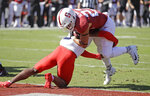 Stanford's Cameron Scarlett (22) breaks the tackle of Arizona's Christian Young for a touchdown during the first half of an NCAA college football game Saturday, Oct. 26, 2019, in Stanford, Calif. (AP Photo/Ben Margot)