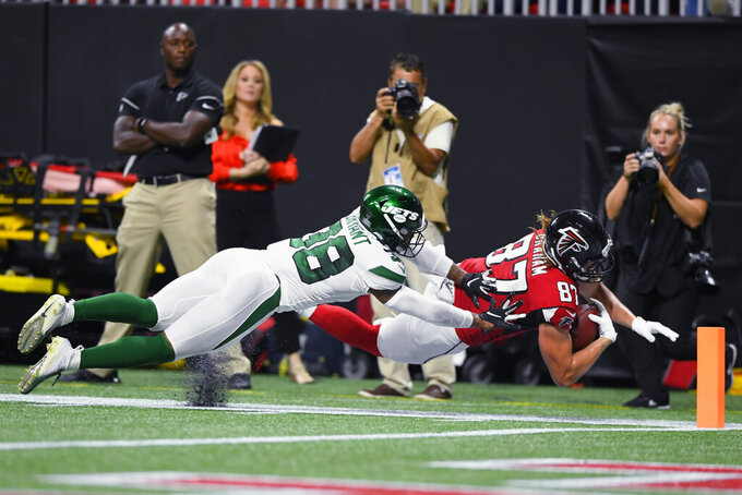Atlanta Falcons tight end Jaeden Graham (87) leaps toward the end zone against New York Jets defensive back Brandon Bryant (38) during the first half an NFL preseason football game, Thursday, Aug. 15, 2019, in Atlanta. (AP Photo/John Amis)