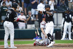 Chicago White Sox's Leury Garcia, right, celebrates with teammate Yasmani Grandal, left, after hitting a two-run home run during the second inning of a baseball game against the Boston Red Sox, Saturday, Sept. 11, 2021, in Chicago. (AP Photo/Jeff Haynes)
