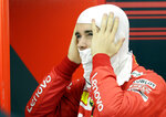 Ferrari driver Charles Leclerc of Monaco prepares for the second free practice at the Formula One Bahrain International Circuit in Sakhir, Bahrain, Friday, March 29, 2019. The Bahrain Formula One Grand Prix will take place on Sunday. (AP Photo/Luca Bruno)