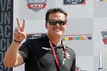 FILE - In this Saturday, June 5, 2021, file photo, car owner Matt Kaulig gestures in Victory Lane after A.J. Allmendinger won a NASCAR Xfinity Series auto race at Mid-Ohio Sports Car Course in Lexington, Ohio. JR Motorsports has had initial conversations about taking its team to NASCAR's top level, a step up to Cup that would be much smoother if it could get its hands on a charter.  Two charters went off the board earlier this month when Kaulig Racing purchased a pair from Spire Motorsports, a team that bought low and stockpiled when potential owners had little interest in NASCAR.  (AP Photo/Tom E. Puskar, File)