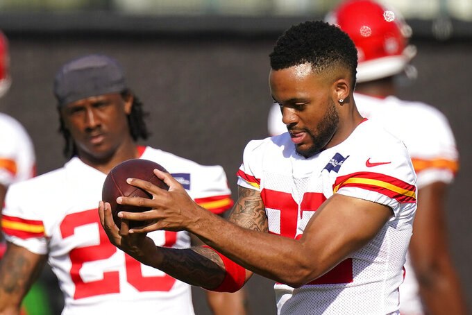 Kansas City Chiefs safety Juan Thornhill, front, catches a ball during an NFL football training camp Saturday, Aug. 15, 2020, in Kansas City, Mo. (AP Photo/Charlie Riedel)