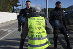 A yellow vest protester wearing a vest that says