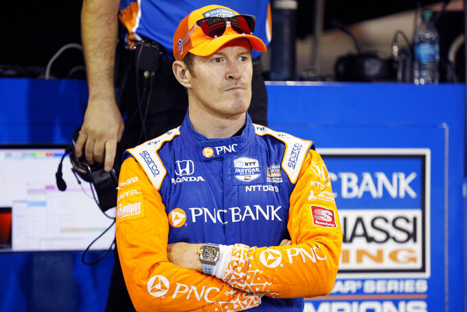 Scott Dixon stands on pit road before an IndyCar Series auto race Saturday, July 20, 2019, at Iowa Speedway in Newton, Iowa. (AP Photo/Charlie Neibergall)