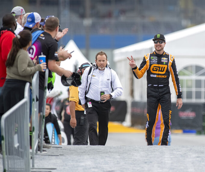Kurt Busch, right, gestures to fans at the Drydene 400 - Monster Energy NASCAR Cup Series playoff auto race, Sunday, Oct. 6, 2019, at Dover International Speedway in Dover, Del. (AP Photo/Jason Minto)