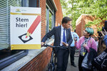 Netherlands Prime Minister Mark Rutte at a polling station in The Hague, Netherlands, Thursday, May 23, 2019, as polls opened in elections for the European Parliament. (AP Photo/Phil Nijhuis)