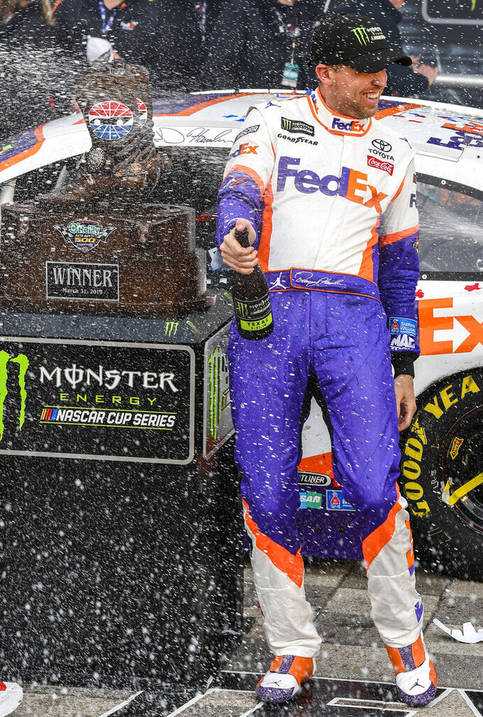 Drive Denny Hamlin celebrates in victory lane after winning a NASCAR Cup auto race at Texas Motor Speedway, Sunday, March 31, 2019, in Fort Worth, Texas. (AP Photo/Larry Papke)