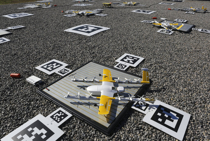 Package carrying drones are dispatched from a launch site the company calls the