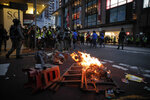 Protesters against the new security law start a fire to block traffic during a march marking the anniversary of the Hong Kong handover from Britain to China, Wednesday, July. 1, 2020, in Hong Kong. Hong Kong marked the 23rd anniversary of its handover to China just one day after China enacted a national security law that cracks down on protests in the territory. (AP Photo/Kin Cheung)