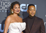 """FILE - In this Jan. 13, 2019 file photo, Chrissy Teigen, left, and John Legend arrive at the 24th annual Critics' Choice Awards at the Barker Hangar in Santa Monica, Calif. President Donald Trump targeted the couple following an MSNBC special on criminal justice reform which Legend appeared on. In a series of tweets late Sunday, Sept. 8 and early Monday, Sept. 9 Trump felt he wasn't getting credit for a law he signed in late December that, among other things, reduces mandatory minimum sentences in some cases. Trump called Legend """"boring"""" and said Teigen was """"filthy mouthed."""" He criticized them for not playing a role in the reform.  (Photo by Jordan Strauss/Invision/AP, File)"""