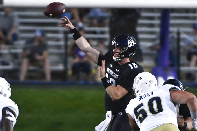 Northwestern quarterback Clayton Thorson (18) passes against Akron during the first half of an NCAA college football game in Evanston, Ill., Saturday, Sept. 15, 2018. (AP Photo/Matt Marton)