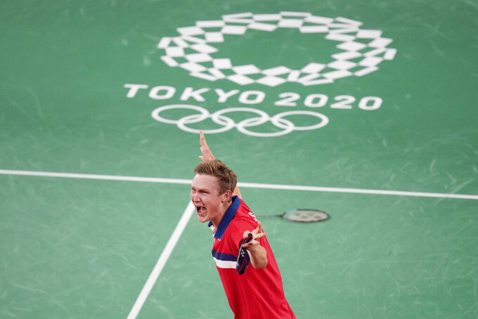 Denmark's Victor Axelsen celebrates after winning against China's Chen Long during their men's singles gold medal Badminton match at the 2020 Summer Olympics, Monday, Aug. 2, 2021, in Tokyo, Japan.(AP Photo/Dita Alangkara)