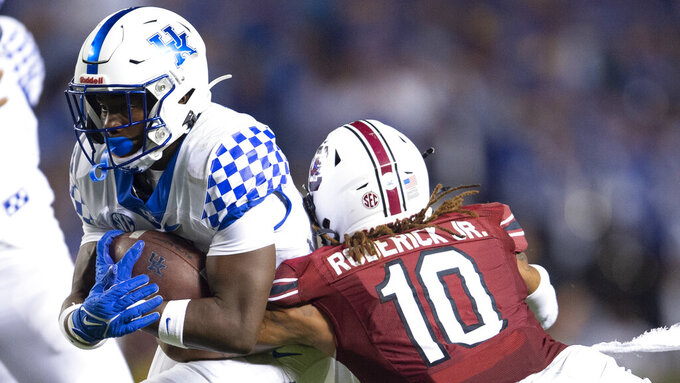 South Carolina defensive back R.J. Roderick (10) tackles Kentucky running back Kavosiey Smoke (0) in the second half of an NCAA college football game. Saturday, Sept. 25, 2021, at Williams-Brice Stadium in Columbia, S.C. (AP Photo/Hakim Wright Sr.)