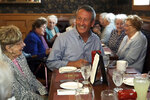 Republican presidential candidate, former South Carolina Gov. Mark Sanford, right, chats withpatrons at the Puritan Backroom restaurant, during a campaign stop, Thursday, Sept. 19, 2019, in Manchester, N.H. (AP Photo/Elise Amendola)