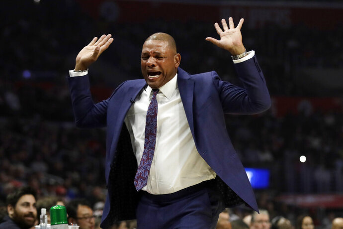 Los Angeles Clippers coach Doc Rivers disagrees about a call during the first half of the team's NBA basketball game against the Portland Trail Blazers on Thursday, Nov. 7, 2019, in Los Angeles. (AP Photo/Marcio Jose Sanchez)