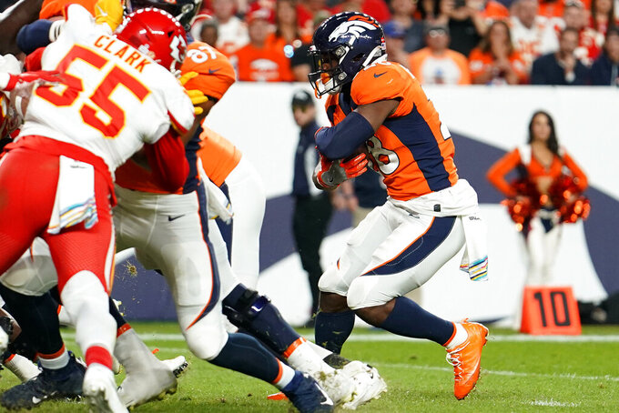 Denver Broncos running back Royce Freeman (28) runs on for a touchdown against the Kansas City Chiefs during the first half of an NFL football game, Thursday, Oct. 17, 2019, in Denver. (AP Photo/Jack Dempsey)