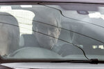 Cardinal George Pell sits in the back seat of a car as he leaves prison in Geelong, Australia Tuesday, April 7, 2020. Pope Francis' former finance minister Pell had been the most senior Catholic found guilty of sexually abusing children and has spent 13 months in high-security prisons before seven High Court judges unanimously dismissed his convictions. (James Ross/AAP Image via AP)