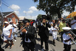 CORRECTS THE NAME OF THE RESTAURANT TO DOOKY CHASE'S - Musicians play in a jazz funeral procession for Leah Chase, as it goes from St. Peter Claver Church to her restaurant
