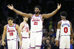 Philadelphia 76ers' Joel Embiid (21) reacts after scoring a basket during the first half of an NBA basketball game against the New Orleans Pelicans, Friday, Dec. 13, 2019, in Philadelphia. (AP Photo/Matt Slocum)