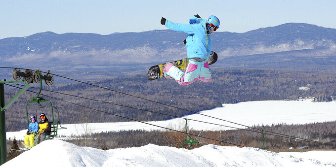 FILE - In this Feb. 23, 2011 file photo, Colby Wheaton, of Phillips, Maine flies over a jump at Saddleback Mountain  in Rangeley, Maine. Saddleback Mountain is reopening in the middle of a pandemic, but General Manager Andy Shepard believes people are hankering to get outside. The mountain is reopening after a five-year hiatus with revamped lodge, a new chairlift and changes in the lodge aimed at making skiing safer. (Russ Dillingham/Sun Journal via AP)